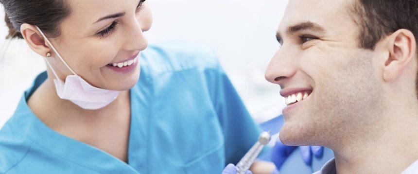 Com qual frequência devo visitar o dentista?